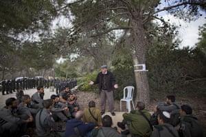 Holocaust memorial: A Holocaust survivor tells his personal testimony to Israeli border police