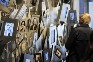 Holocaust memorial: An elderly man looks at the portraits of Macedonian Jews who were killed