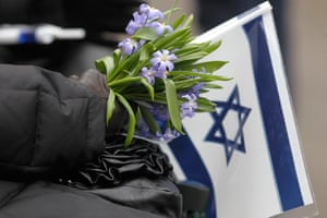 Holocaust memorial: A woman holds flowers and Israel's flag at the March of the Living