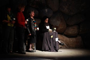 Holocaust memorial: Women hold flowers at Yad Vashem Holocaust Memorial in Jerusalem