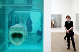Damien Hirst: A visitor contemplates Damien Hirst's shark