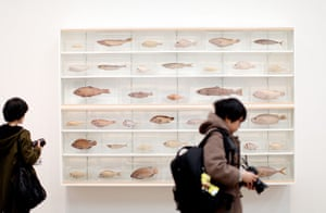 Damien Hirst: Visitors walk past a vitrine of dead fish in the Damien Hirst exhibition