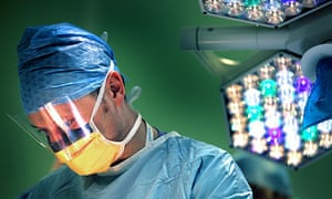 A surgeon performs an operation