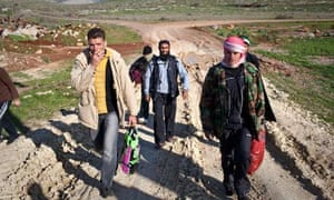 Refugees cross from Syria into Turkey