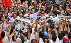 Aung San Suu Kyi waves to the crowd in Burma, with her party celebrating a major victory
