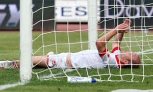 Bari defender Andrea Masiello reacts after scoring an own goal during a Serie A match against Lecce