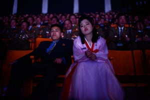 Longer view: North Koreans watch a performance in a theatre