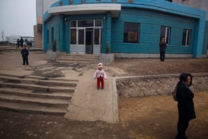 Longer view: North Korean residents of the capital city mingle