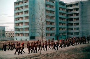 Longer view: A North Korean soldiers are seen from the window of a train
