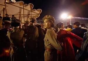 Longer view: A dancer dressed as a soldier takes part in gala show in Pyongyang