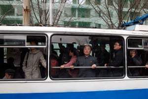 Longer view: A North Korean man looks out from the window of a public bus in Pyongyang