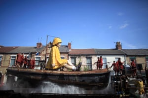 Liverpool Royal de Luxe: The Little Girl Giant Marionette makes her way through the streets