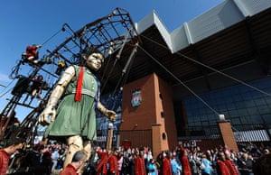 Liverpool Royal de Luxe: A giant puppet walks past Anfield Stadium