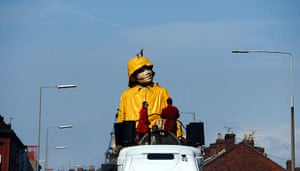 Liverpool Royal de Luxe: A giant puppet is prepared to be lifted from a boat outside Liverpool