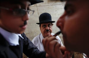 From the Agencies: Ashok Aswani watches as a member of his club has his make-up applied