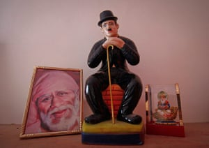 From the Agencies: A statue of Chaplin is kept next to Hindu Gods