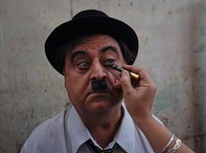 From the Agencies: Ashok Aswani has his Charlie Chaplin make-up applied
