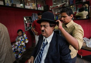 From the Agencies: Aswani has his Charlie Chaplin hat carefully positioned by his barber
