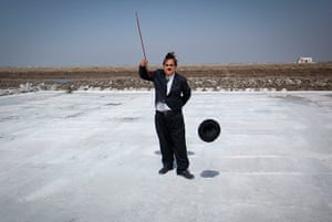 From the Agencies: Aswani poses on a salt pan in Adipur with his Charlie Chaplin hat and stick