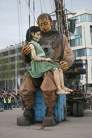 Liverpool Puppets: The little girl giant and her uncle hug after reuniting