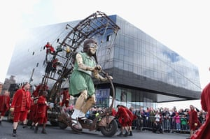 Liverpool Puppets: The little girl giant rides her bike