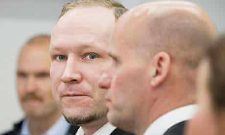 Anders Behring Breivik stands with his defence lawyer Geir Lippestad
