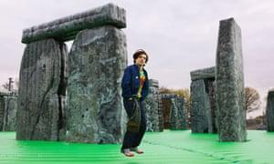 Jeremy Deller bounces on Sacrilege, his bouncy castle artwork in the shape of Stone Henge