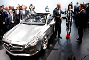 Beijing motor show: Dr Dieter Zetsche, Daimler AG's Chief Executive Officer poses with Jessie J