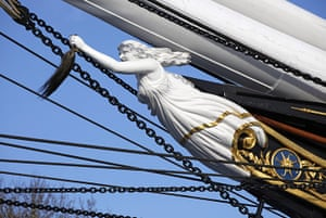 Cutty Sark: Figurehead of the Cutty Sark Clipper Ship holding hair from a horse's tail