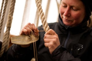 Cutty Sark photo call: Rigging specialist Emilia Hall works on the whipping of the Cutty Sark