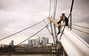 Cutty Sark photo call: Rigging sit on the mast as they work on the newly-restored Cutty Sark