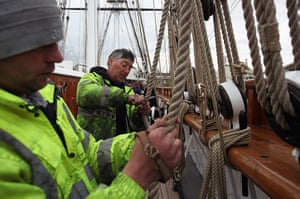 Cutty Sark photo call: Final adjustments are made to the ropes of the newly refurbished Cutty Sark
