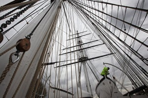 Cutty Sark photo call: A workman makes final adjustments to the rigging on the Cutty Sark
