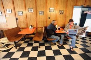 Booneville, Kentucky: A man reads a newspaper in a restaurant