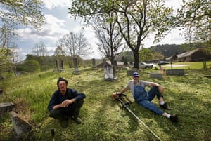 Booneville, Kentucky: Men sit while taking a break from cleaning a cemetery