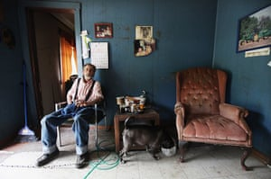 Booneville, Kentucky: Paul Neace sits in his home in Owsley County