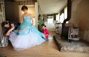 Booneville, Kentucky: Girl fixes her gown as she prepares for the Owsley County High School prom