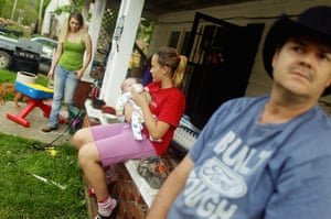 Booneville, Kentucky: Family member gather on the porch