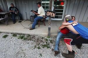 Booneville, Kentucky: Revelers hug at Joe's Meat Market #2 in Owsley County