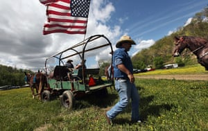Booneville, Kentucky: A man walks by his carriage at the Owsley County Saddle Club trail ride