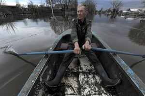 24 hours: Kadom, Russia: A man rows a boat in a flooded town in the Ryazan Region