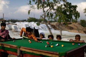 24 hours: Islamabad, Pakistan: Men play a game of pool in a slum