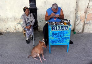 24 hours: Havana, Cuba: A privately licensed watchmaker with works at his stall