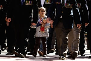 24 hours: Sydney, Australia: A young girl marches along George Street on ANZAC Day
