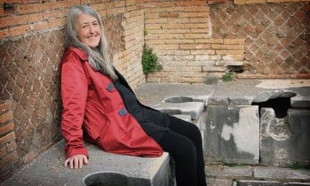 Mary Beard sitting on Ostia latrines in Rome