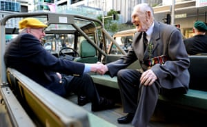 Anzac Day: Second World war veterans shake hands in Sydney