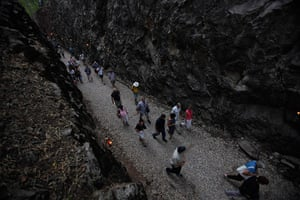 Anzac Day: Australians walk along Hellfire Pass after a memorial ceremony in Thailand