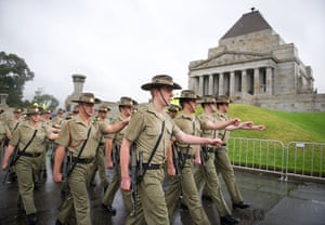 Anzac Day: Soldiers march past the Shrine of Remembrance in Melbourne, Australia