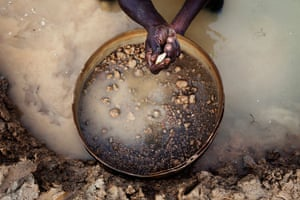 Sierra Leone after Taylor: An artisanal miner pans for diamonds in the town of Koidu