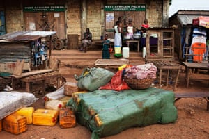 Sierra Leone after Taylor: Containers of palm oil lie in front of a store in the town of Kailahun